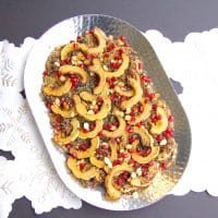 Maple-roasted delicata squash tops cider-infused quinoa and is garnished with thyme and pomegranate seeds in this easy, yet elegant side dish that's perfect for the holidays or any day of the week. Vegan, gluten-free, and nut-free recipe.