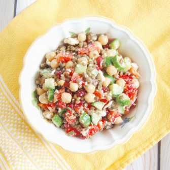 Lentil Chickpea Vegetable Salad with Feta | Protein- and fiber-rich lentils and chickpeas, crunchy bell peppers and Persian cucumbers, sweet pomegranate seeds, and salty feta cheese are tossed together in a lemony maple-mustard vinaigrette for a kid-friendly and adult approved lunchbox salad. Get this gluten-free, nut-free, vegetarian, and vegan-friendly recipe @jlevinsonrd.