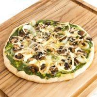 Mushroom Pesto Pizza | Sautéed mushrooms, nut-free kale pesto, fresh mozzarella and a drizzle of truffle oil pair beautifully in this gourmet homemade pizza. Get the vegetarian and nut-free recipe @jlevinsonrd.