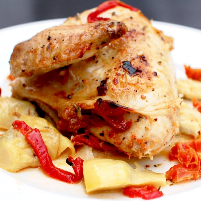 plate of roasted chicken with artichokes