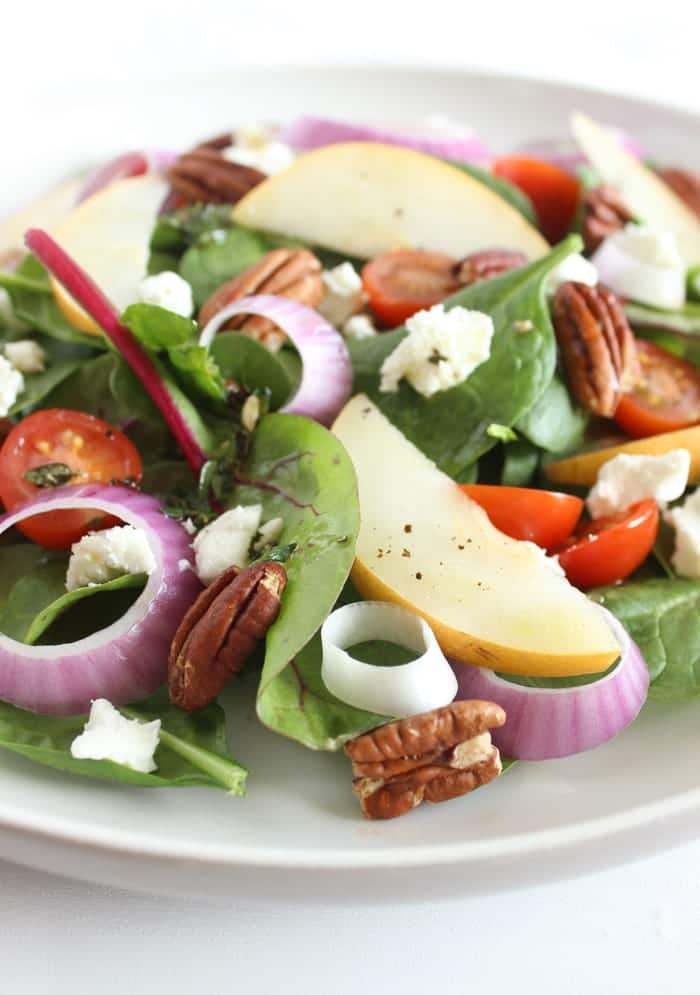 Close Up of Spinach Pear Salad with Goat Cheese