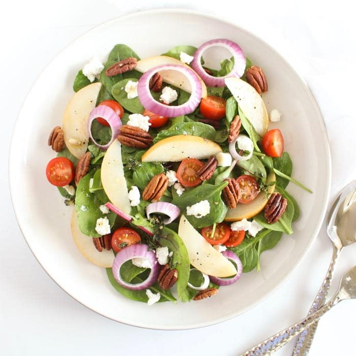 Spinach Pear Salad in White Bowl Overhead
