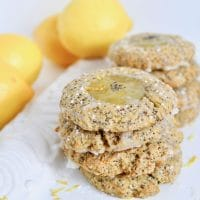 Welcome spring with this sweet and tangy Lemon Poppy Seed Thumbprint Cookie recipe! Soft and chewy lemon poppy seed cookies are dolloped with zesty lemon curd and a simple glaze for the perfect springtime treat. Get the vegetarian and nut-free recipe at JessicaLevinson.com
