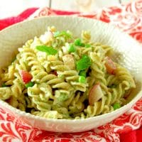 Whole grain pasta is tossed with peas, roasted radishes, and a nut-free mint and radish greens pesto in this light and delicious spring pasta dish. #vegetarian #nutfree #glutenfreefriendly #pesto #springrecipes #mint #pasta