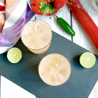 Spicy Strawberry Rhubarb Margaritas are the perfect complement for Taco Tuesdays or any Mexican-themed party during the spring and summer. Get the cocktail recipe @jlevinsonrd.
