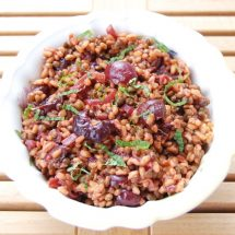 Roasted Cherry Farro Salad is a sweet and savory dish hearty enough for a light lunch and perfect as a side dish next to your favorite entrée. Get the vegan and nut-free recipe @jlevinsonrd.