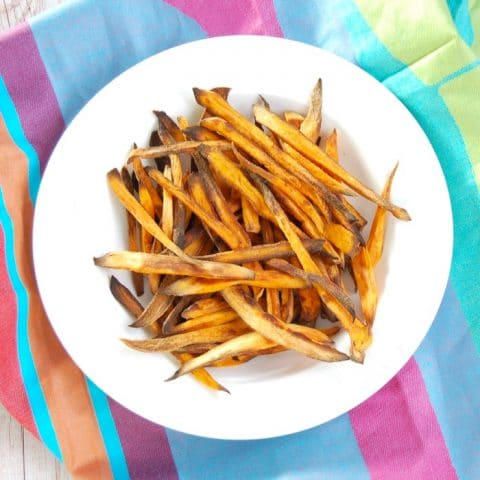 Crispy baked sweet potato fries are easy to make, kid-friendly, and delicious. The perfect side dish for any weeknight family dinner! Get the recipe at JessicaLevinson.com | #GlutenFree #Vegan #recipe #sweetpotato #frenchfries #vegetarian #healthyrecipes #recipemakeover
