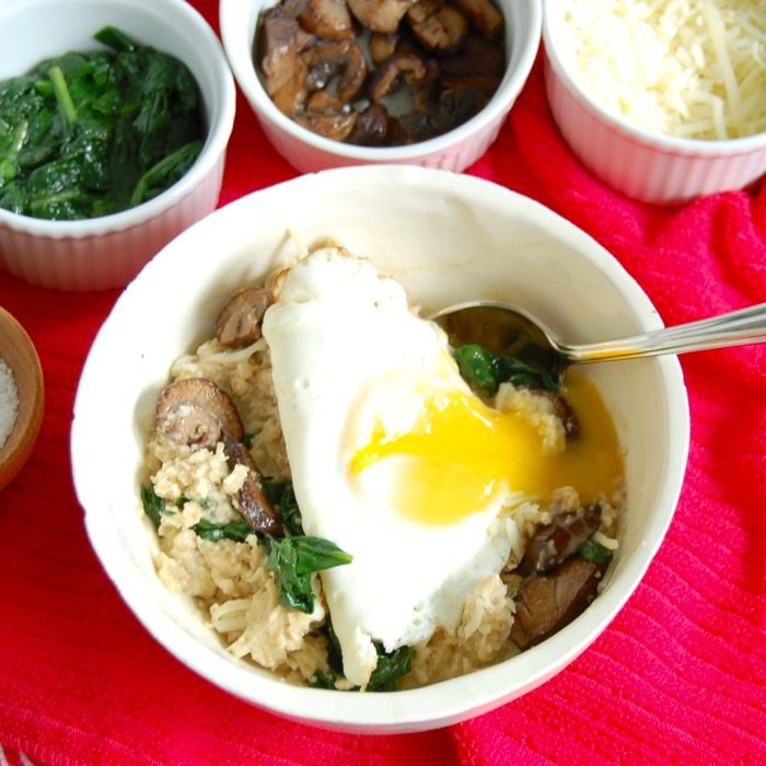 savory oatmeal bowl with runny fried egg