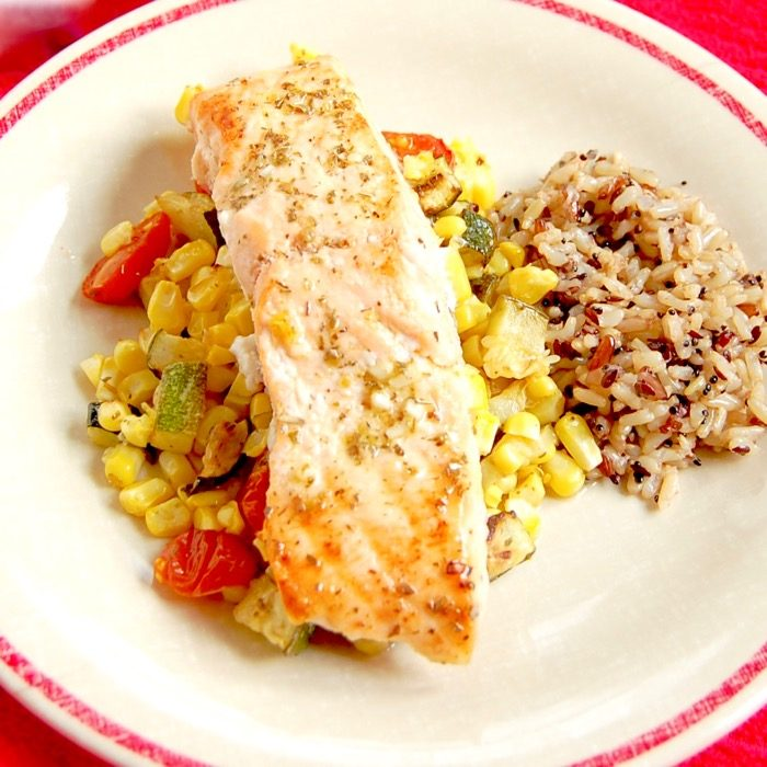 Mediterranean Sheet Pan Salmon with Zucchini, Corn, and Tomatoes is quick and easy to make and clean up. A perfect weeknight dinner for busy families. Get the recipe at JessicaLevinson.com | #glutenfree #dairyfree #eggfree #nutfree #salmon #recipe #sheetpanmeal #sheetpandinner #zucchini #corn #tomatoes #summerrecipes #summerveggies