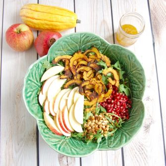 Enjoy the flavors of fall with this pretty and delicious Roasted Delicata Squash Apple Salad. A perfect side dish or starter salad, especially for the holidays. via JessicaLevinson.com | #pomegranates #delicatasquash #fallrecipes #salad #vegan #dairyfree #glutenfree #nutfree #apples