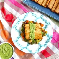 Grilled or broiled tofu is topped with smooth and delicious cilantro avocado cream sauce. This vegan and gluten-free meal is a quick and easy weeknight dinner to enjoy all year long.