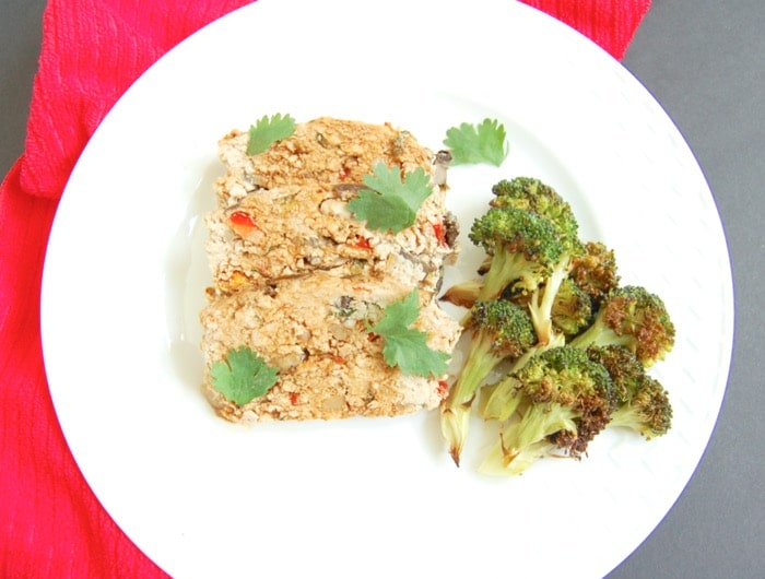 Asian-style turkey meatloaf sliced on plate with broccoli