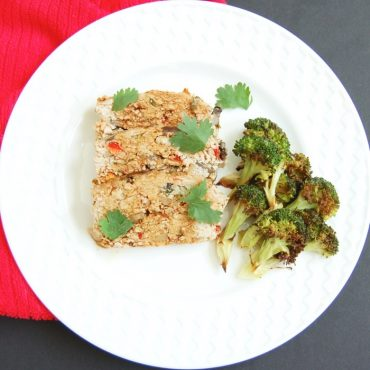 A twist on classic meatloaf, this Asian-style turkey meatloaf is loaded with vegetables, herbs and spices, and topped with a sweet and spicy glaze.