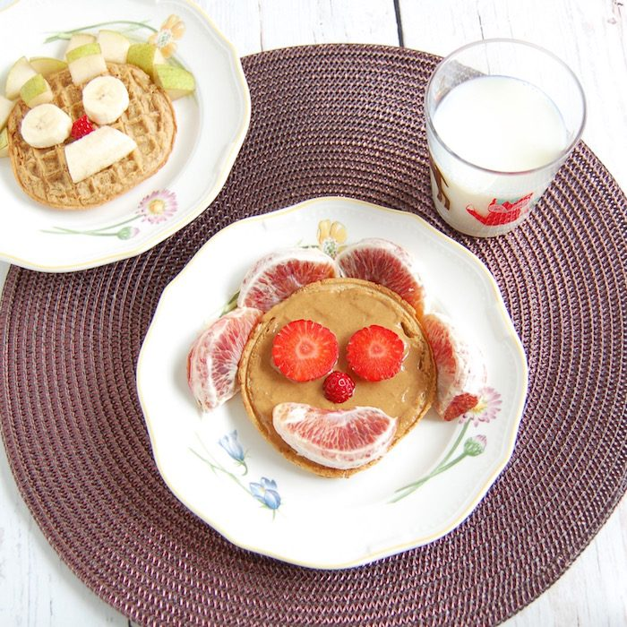 frozen whole grain waffles topped with peanut butter and fruit are one of many healthy breakfasts to get out the door in the morning