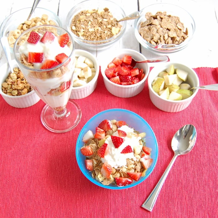Yogurt and cottage cheese parfait with whole grain cereal and fruit