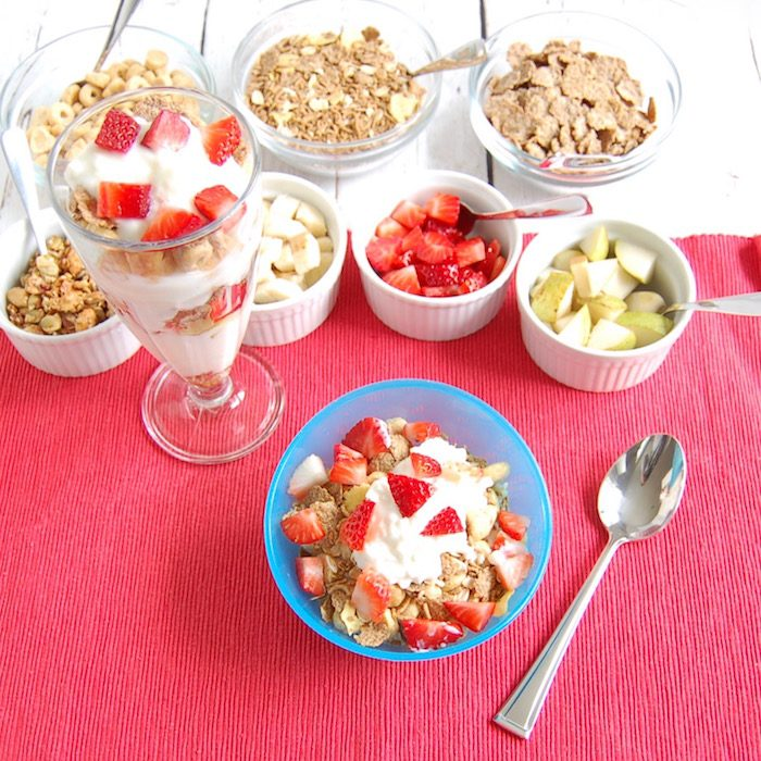 yogurt or cottage cheese parfaits topped with fruit and whole grain cereals are one of many healthy breakfasts to get out the door in the morning