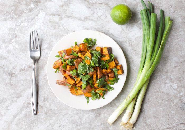 Roasted Sweet Potato Salad on Plate with Lime and Scallions