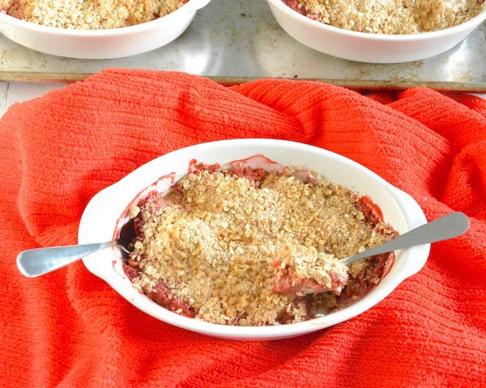 Strawberry Rhubarb Crisp in Dish with Two Spoons