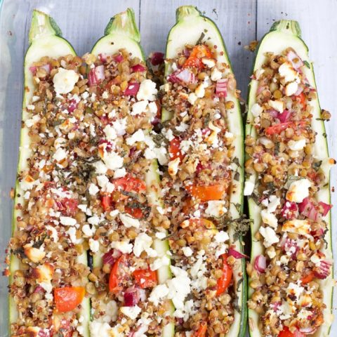 These Vegetarian Greek Lentil Stuffed Zucchini Boats are the ultimate meatless dinner idea to use up that end of summer produce! Get the recipe at JessicaLevinson.com | #Recipe #Vegetarian #Glutenfree #Zucchini #Summer #Meatless #Lentils #Legumes