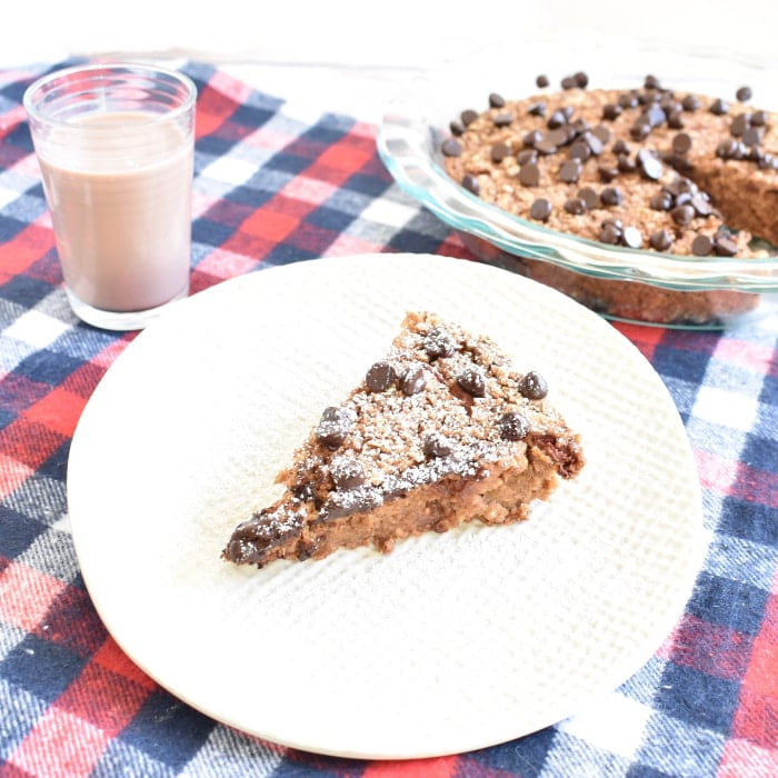 Baked Oatmeal with Berries and glass of chocolate almondmilk
