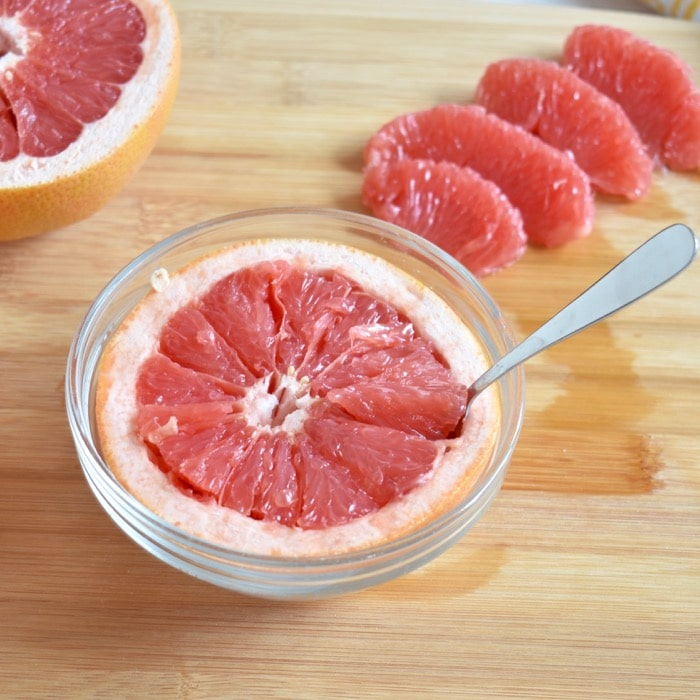 Enjoy grapefruit cut in half and eaten by spoon