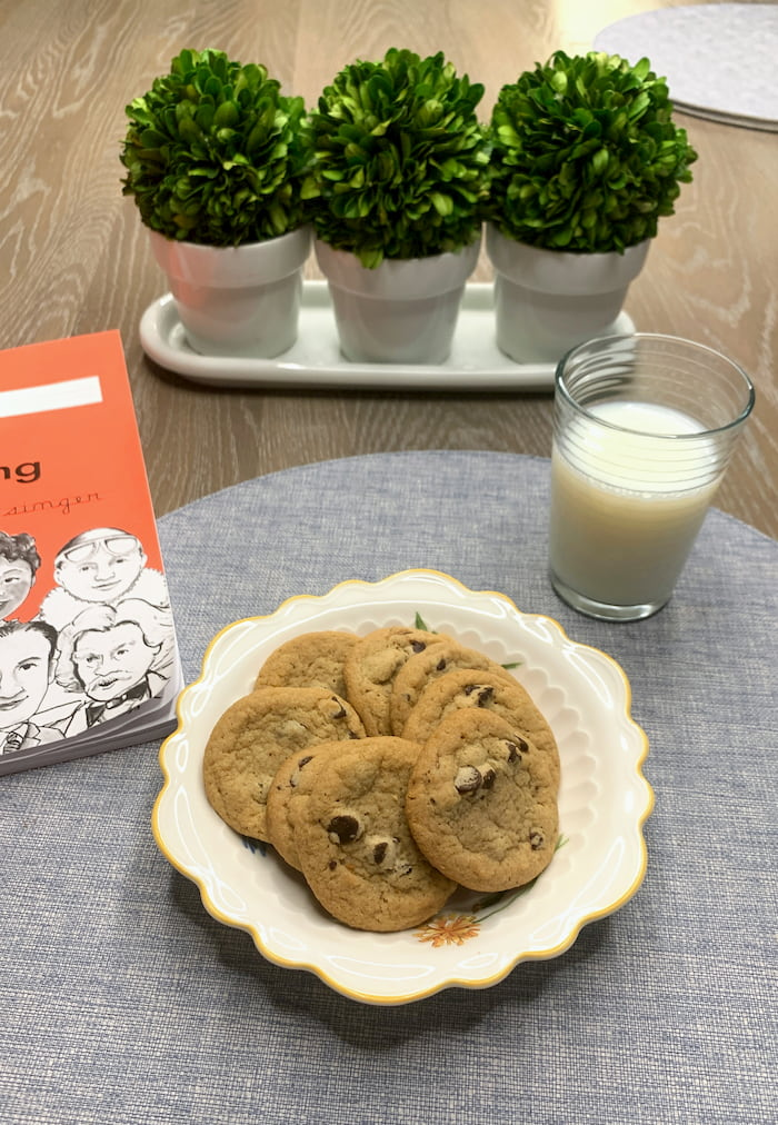 plate of cookies with a glass of milk